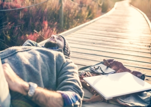 man-relaxing-thinking-sad-laptop-technology-unplug-nature-alone